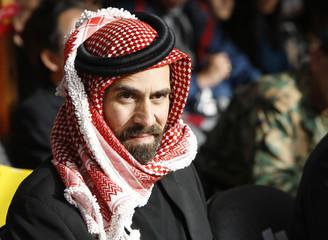 Jordan's Prince Ghazi bin Muhammad bin Talal attends a baptism ceremony in the Jordan River