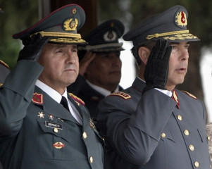 Chile's Army Commander General Uzurrieta and his Bolivian counterpart General Bersatti salute during a military ceremony in La Paz