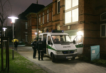 Police guard an entrance of the department for Nuclear Medicine and Contamination at the St. Georg hospital in Hamburg