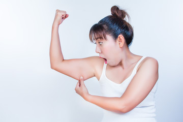 asian woman checking her upper arm