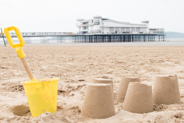 Yellow Bucket and Spade with Sandcastles