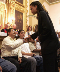Jose, an illegal immigrant from Mexico facing deportation, shakes hands with Reverend Monica Cummings from the Unitarian Church during the public launch of The New Sanctuary Movement in Los Angeles