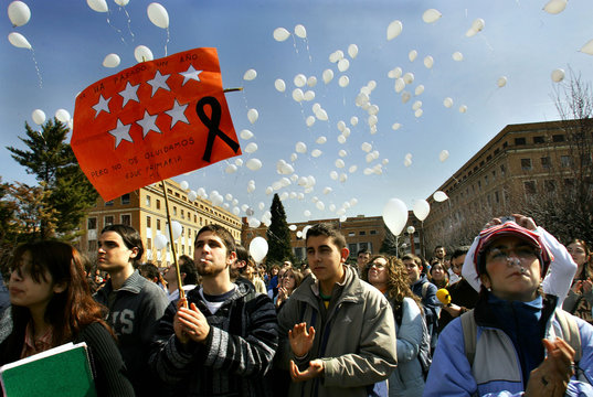 Students applaud after letting go balloons to mark March 11 train bombings in Madrid.