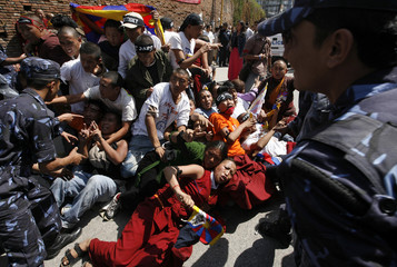 Tibetan nuns are dragged by police while being detained in Kathmandu
