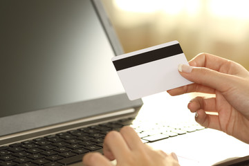 Girl hands holding credit card and buying on line