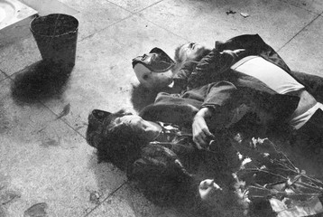 File photo of the bodies of Romanian actor Caciulescu and an unknown person lying on the floor inside the autopsy room of Coltea hospital in Buchares