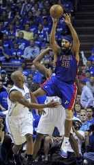 Detroit Pistons' Rasheed Wallace looks to pass as the Orlando Magic's Keith Bogans defends in Orlando