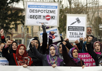 Demonstrators chant slogans during protest against Turkey's Constituional Court decision to open case against ruling AK Party in Istanbul