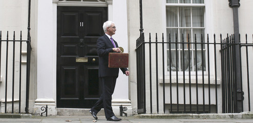 Britain's Chancellor of the Exchequer Darling leaves 11 Downing Street to deliver his first Budget to the House of Commons in central London