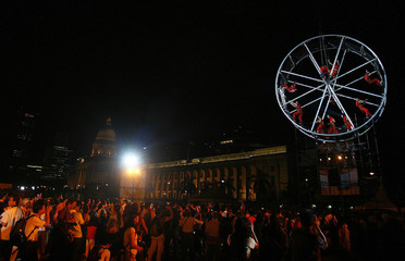 "Artistes from La Fura dels Baus of Spain perform ""Dreams In Flight"" in a giant wheel at the Padang in Singapore"