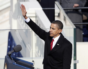 U.S. President Barack Obama waves to crowd ollowing speech during inauguration ceremony in Washington