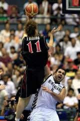 Japan's Amino shoots over New Zealand's Pero Cameron at world basketball championships in Hiroshima