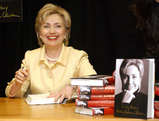 """Senator Hillary Clinton shows off her new book, titled """"Living History,"""" in New York, June 9, 2003, .."""