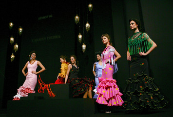 Models present creations from Piedra during International Flamenco Fashion Show in Seville