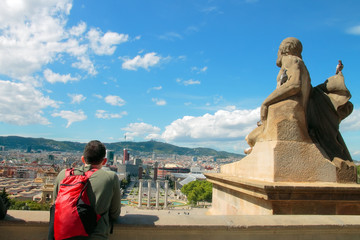 Young tourist enjoying panorama of Barcelona from the hill of Montjuic