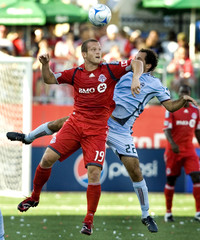 Toronto FC's Barrett battles for possession against Colorado Rapids LaBrocca in the second half of their MLS soccer game in Toronto