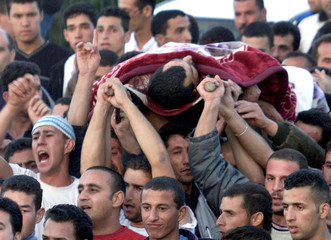 PALESTINIANS CARRY BODY OF PALESTINIAN DOCTOR DURING HIS FUNERAL IN THEEAST OF JERUSALEM.