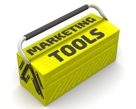 """Marketing tools. Closed yellow tool box on a white surface with text """"MARKETING TOOLS"""". Isolated. 3D Illustration"""