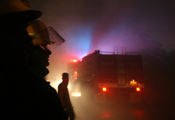 Sri Lankan fire fighters attempt to extinguish a fire at Bata shoe factory south of Colombo.