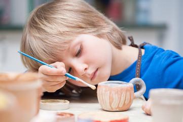 boys make a product made of ceramics