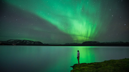 Aluminium Prints Northern lights Man with Northern Lights reflection