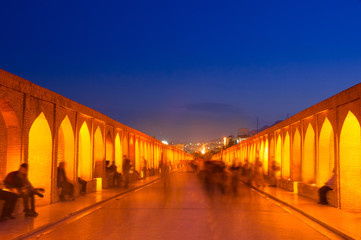 Night view of  Si-o-seh pol bridge in Isfahan - Iran. Si-o-seh pol bridge is one of the most famous places of tourists and locals to relax, even picnic.Unrecognized Tourists capturing in Motion blur.