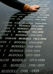 A Kosovo Albanian man visits a memorial for the dead from Kosovo's 1998-99 war in the town of Glogov..