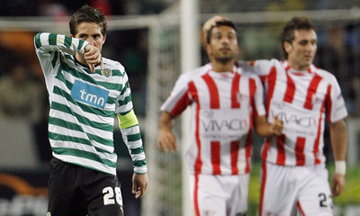 Sporting's Moutinho reacts as Leixoes' Sousa celebrates his goal against Sporting with his team mate Valente during their Portuguese Premier League soccer match in Lisbon