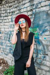 Fashion pretty woman model wearing a red hat