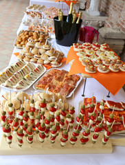 Tasty sandwiches and many snack food on the table of restaurant