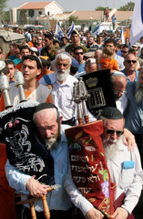 Jewish settlers carry Torah Scrolls out of the synagogue in Netzarim in the Gaza Strip.