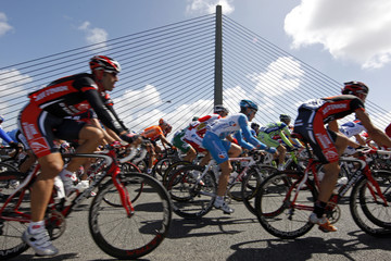 The pack of riders cycles on the Iroise bridge  after the start of the first stage of the 95th Tour de France cycling race between Brest and Plumelec