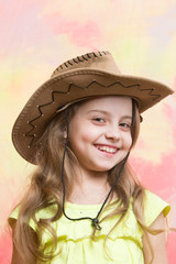 beautiful little girl in fashion cowboy hat has happy face