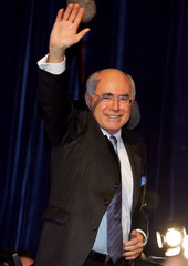 Australian Prime Minister John Howard waves to the crowd after winning the federal election for a ...