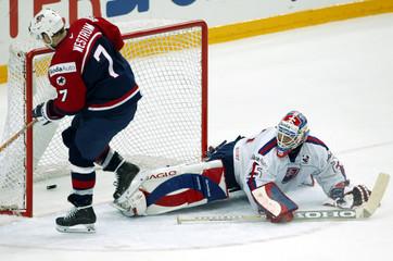 USA'S WESTRUM SCORES HIS TEAM'S WINNING GOAL ON SLOVAKIA'S GOALTENDER LASAK DURING THEIR ...