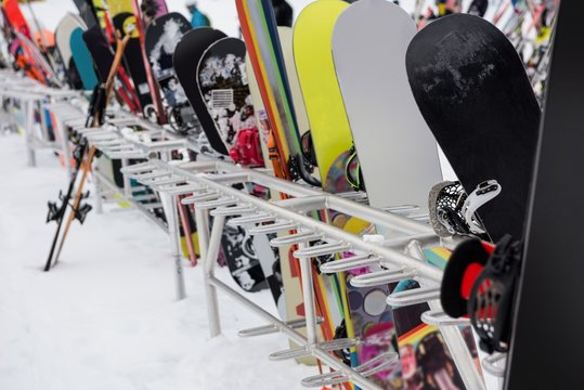 Snowboards and skis kept together