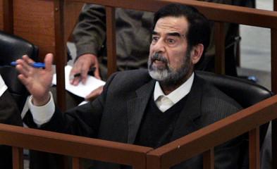 Former Iraqi President Saddam Hussein speaks to head judge in Baghdad