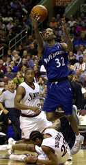 WIZARDS HAMILTON TAKES A JUMP OVER THE SIXERS BUFORD.