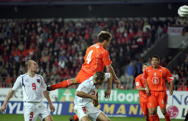 Netherlands' Opdam heads the ball over the Czech Republic's Polak to score during the World Cup 2006 qualifying soccer match in Prague