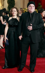 """Hoffman, best supporting actor for his work in """"Doubt"""", and his girlfriend O'Donnell pose for photographers on red carpet in Hollywood"""