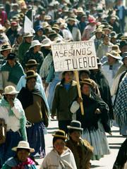 THOUSANDS OF BOLIVIANS MARCH INTO LA PAZ.