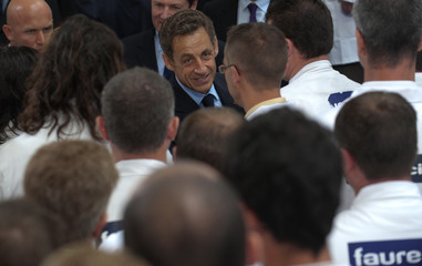 France's President Sarkozy speaks with workers at Faurecia car seats manufacturer plant in North-western France