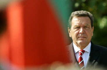 German Chancellor Gerhard Schroeder listens to national anthem in Sofia.