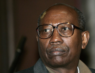 Former Rwandan Army Major Bernard Ntuyahaga waits for the start of his trial at a court in Brussels