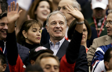 Canada PM Paul Martin is surrounded by Canadian Football League fans at the 93rd Grey Cup in Vancouver British Columbia