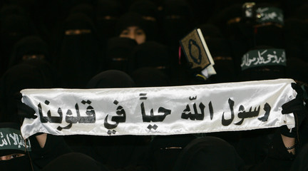 Women attend a rally in Sanaa against the recent reproduction of cartoons depicting Prophet Mohammad by Danish newspapers