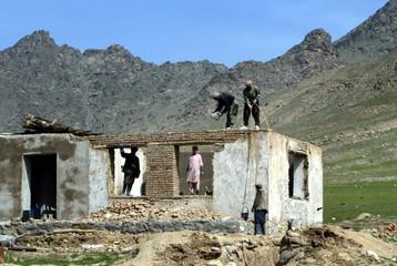 AFGHAN VILLAGERS REBUILD HOUSES NEAR KABUL, AFGHANISTAN.