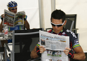 Silence Lotto team rider McEwen  reads the paper before the start of the fifth stage of the Tour de Suisse cycling race in Domat-Ems