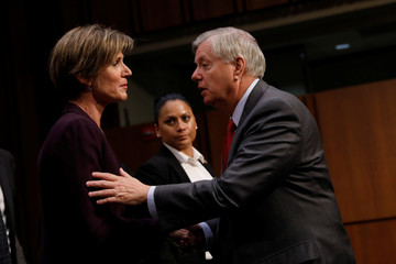 Sen. Lindsey Graham (R-SC) greets former Acting Attorney General Sally Yates after she testified about potential Russian interference in the presidential election before the Senate Judiciary Committee on Capitol Hill