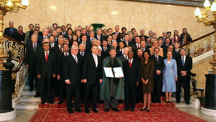 Delegates pose for a group photograph at the London Conference on Afghanistan in central London, Jan..